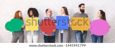 Sharing ideas. Group of millennials holding blank colorful speech bubbles with empty space, panorama #1445941799