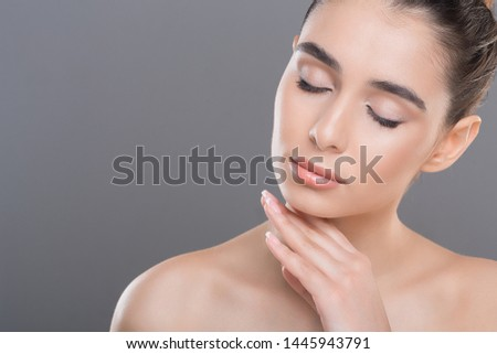 Natural skincare. Young woman caressing her smooth soft skin with closed eyes, copy space #1445943791