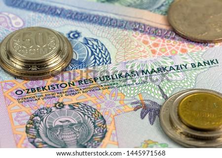 some Uzbek coins and banknotes indicating growing economy of Uzbekistan #1445971568