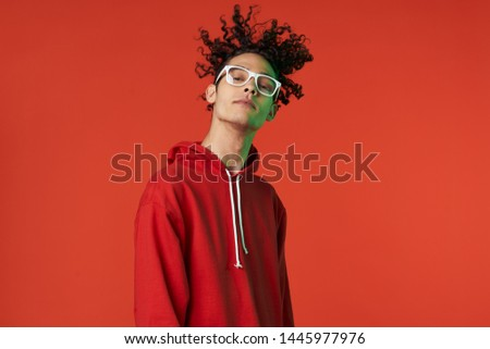 african man with glasses on red background                                #1445977976