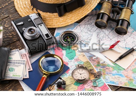 items and accessories for the traveler on the old background on the table #1446008975