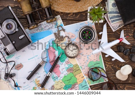 items and accessories for the traveler on the old background on the table #1446009044