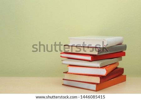 Stack of books on shelf #1446085415