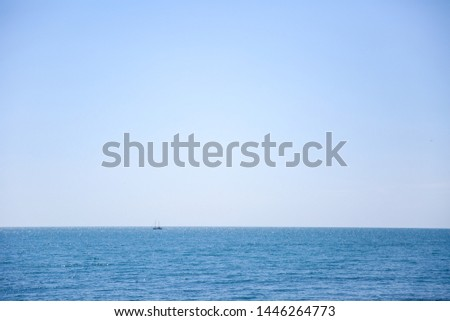 background from sea to horizon. boat is on horizon #1446264773