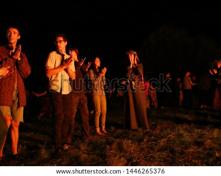 Dudutki/ Belarus - June 22 2019: People are dancing around a fire. The celebration of the pagan Slavic holiday of Ivan Kupala Day or Midsummer. Belarus national traditions #1446265376
