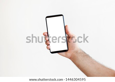 Touch screen mobile phone, in hand with clipping path #1446304595