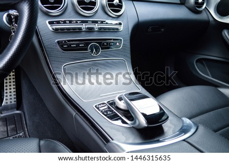 Yerevan, Armenia - 07 July 2019. Black leather interior of new Mercedes-Benz C-class coupe. Black seats, black dashboard and black wooden panels. #1446315635