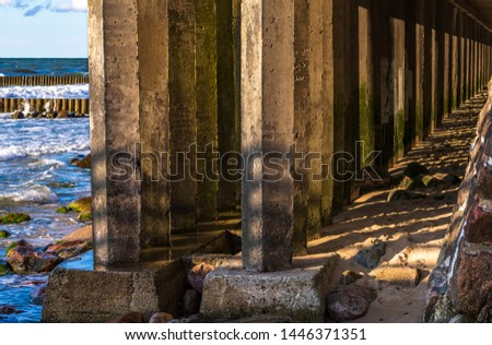 Colonnade of concrete supports holding the promenade #1446371351