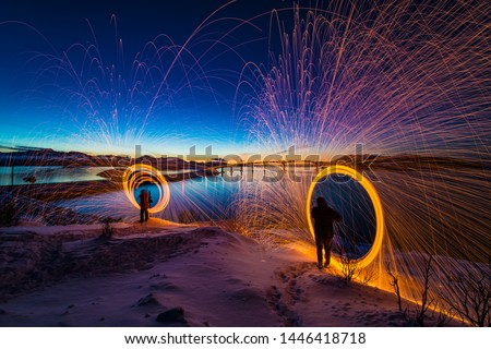Sommaroy Northern Norway light painting sparks spinning photography amazing Scandinavian sunset landscape   Norwegian Fjords natural wonders Northern Europe