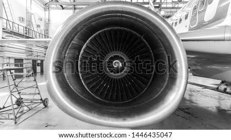 Close-up view of the jet engine of the aircraft. Black and white photo.