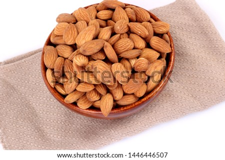Almonds in brown bowl on white background – Image #1446446507