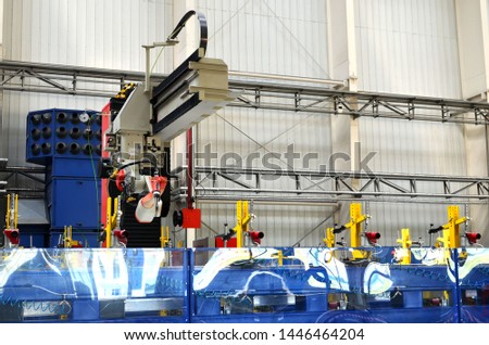 Robotic welding complex in the production workshop of an industrial plant. Complex production line, industrial robot in the automated filling factory. Arc welding background - Image #1446464204