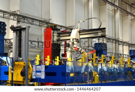 Robotic welding complex in the production workshop of an industrial plant. Complex production line, industrial robot in the automated filling factory. Arc welding background - Image #1446464207