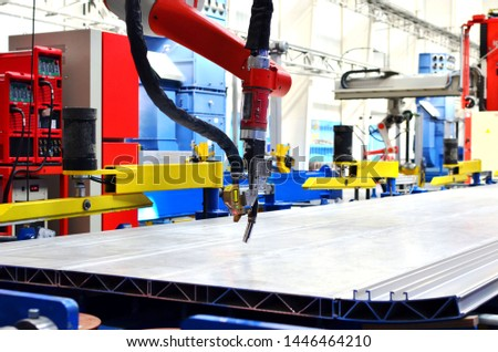 Robotic welding complex in the production workshop of an industrial plant. Complex production line, industrial robot in the automated filling factory. Arc welding background - Image #1446464210
