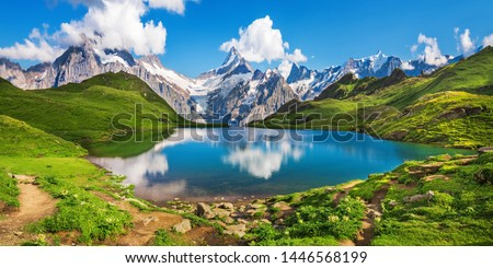 Sunrise  view on Bernese range above Bachalpsee lake. Popular tourist attraction. Location place Swiss alps, Grindelwald valley, Europe.  Royalty-Free Stock Photo #1446568199