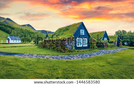 Typical view of turf-top houses in Icelandic countryside. Dramatic summer sunrise in Skogar village, south Iceland, Europe. Traveling concept background. #1446583580