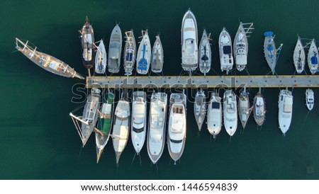 Aerial top view photo of boats docked in Mediterranean destination port marina #1446594839