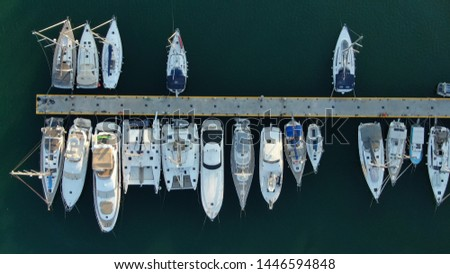 Aerial top view photo of boats docked in Mediterranean destination port marina #1446594848