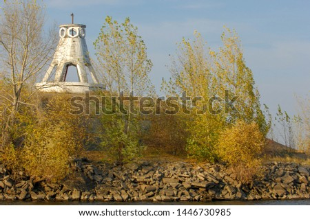 Autumn landscape, river, windy weather, dark blue water, yellow-red autumn leaves on trees, last warm days #1446730985
