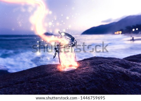 Magical Light And Dust Coming Out Of Mason Jar On Tropical Beach At Sunset Magic Vacation Tourism Concept #1446759695