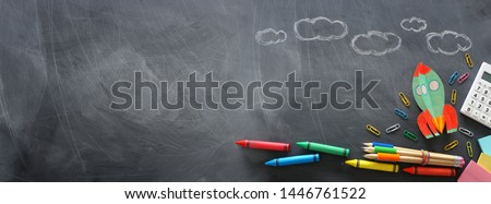 education. Back to school concept. rocket cut from paper and painted over blackboard background. top view, flat lay. banner #1446761522