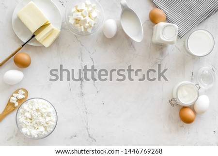 Breakfast on farm with dairy products on marble background top view space for text #1446769268