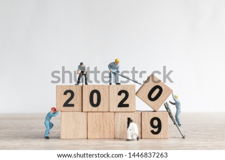Miniature worker team create number 2020 and remove number 2019  , Happy new year 2019 concept #1446837263