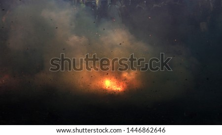 A photograph of fireworks being set off at a street festival in Taiwan with smoke, debris and noise abstracting the image. Royalty-Free Stock Photo #1446862646