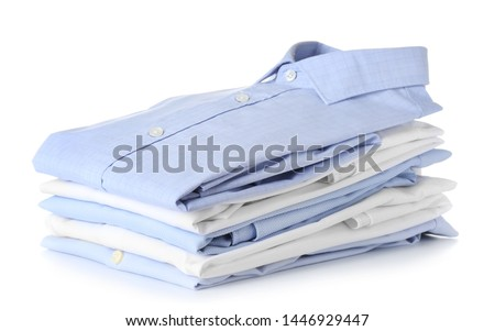Stack of clean clothes on white background #1446929447