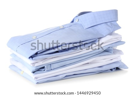 Stack of clean clothes on white background #1446929450