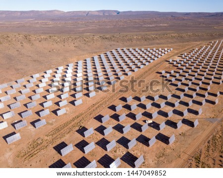 Aerial over solar panels in a dry landscape #1447049852
