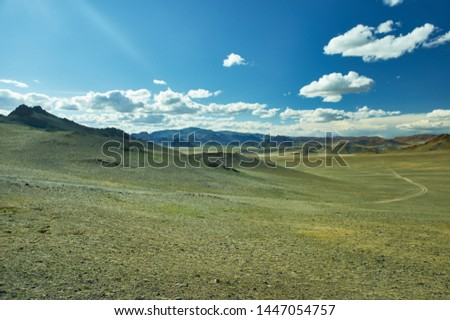 Mongolian Altai.  Scenic valley on the background of the snowcapped mountains. #1447054757