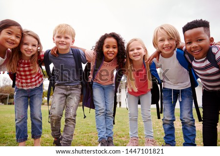 Portrait Of Excited Elementary School Pupils On Playing Field At Break Time Royalty-Free Stock Photo #1447101821