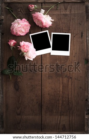 vintage photos frame on wood with rose