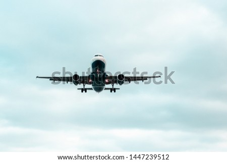 An airplane flying up in the sky with a beautiful blue sky in the background #1447239512