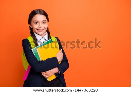 Close up photo beautiful she her little lady funky funny hairdo hands arms learn notebooks glad return see classmates wear formalwear shirt blazer school form bag isolated bright orange background #1447363220