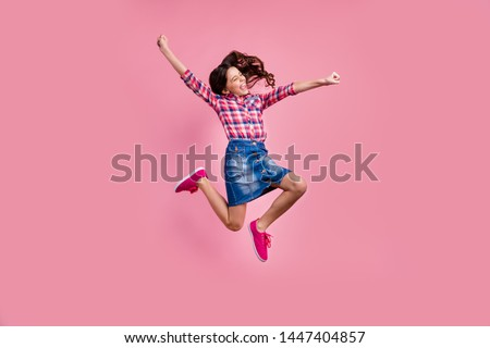 Full length body size view photo delighted funny lady people young person raise hands fists scream yeah achievement content isolated wear fashionable plaid denim jeans skirt outfit pastel background #1447404857