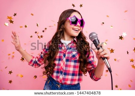 Close up photo of cool attractive  crazy lady kid have fun visit event future musician loud voice solo hold hand free time stylish checked shirt isolated over pink background long haircut hairdo #1447404878