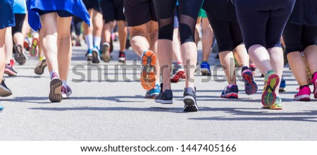 runners feet foot in a competion back side sports background #1447405166
