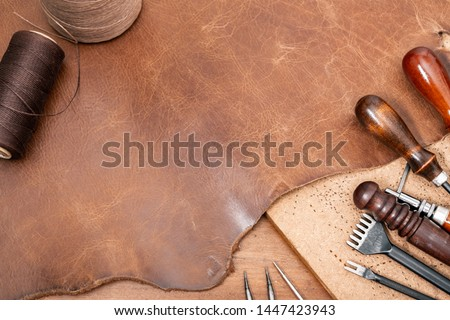 closeup details of brown leather, material for leather working. Royalty-Free Stock Photo #1447423943