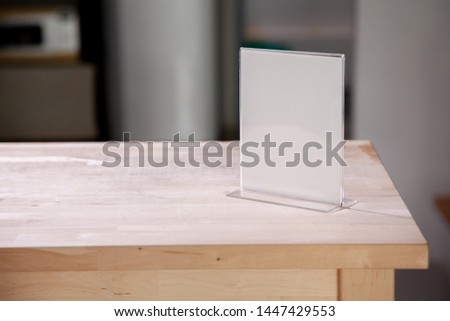White label on the table. Stand for acrylic tent card Used for Menu Bar and restaurant or put everything into it . mockup