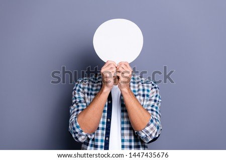 Close up photo handsome he him his guy arms hands holding round circle shape figure paper list hiding head faceless person no emotions wear casual plaid checkered shirt isolated grey background #1447435676