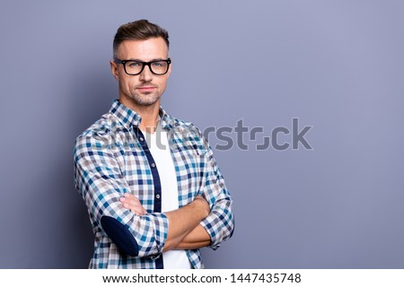 Close up side profile photo intelligent he him his guy arms crossed reliable strict manager not smile self-confident self-assured wear specs casual plaid checkered shirt isolated grey background #1447435748