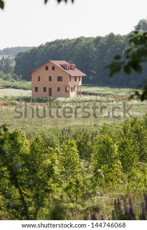 Unfinished wooden house #144746068