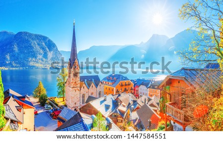 Austria, Hallstatt historical village. UNESCO world heritage site, old European architecture in sunlight. Hallstatter see in background. Hallstatt is iconic world landmark. Autumn seasonal landscape. Royalty-Free Stock Photo #1447584551