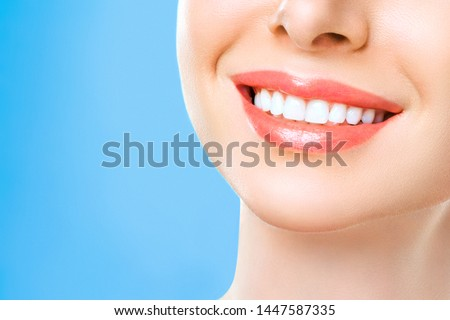 Perfect healthy teeth smile of a woman. Teeth Whitening. Dental health Concept. Promotional picture for a dental clinic. #1447587335