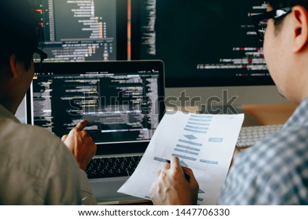 Developing programming and coding technologies working in a software engineers developing applications together in office. #1447706330