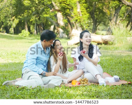 The Portrait moments of happy family picnic in the park. #1447786523