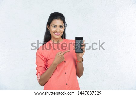indian beautiful woman holding phone and talking in white background #1447837529