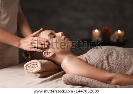 Young woman having massage in spa salon #1447852889